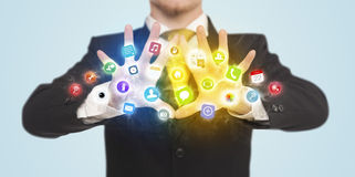 Hands creating a form with mobile app icons Stock Image