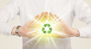 Hands creating a form with recycling sign Royalty Free Stock Photos