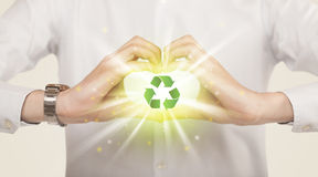 Hands creating a form with recycling sign Stock Photography