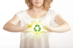 Hands creating a form with recycling sign Stock Image