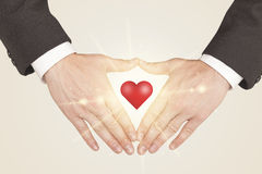 Hands creating a form with shining heart Royalty Free Stock Images