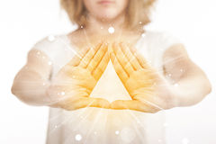 Hands creating a form with yellow shines Royalty Free Stock Photos