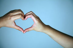 Hands creating heart shape Royalty Free Stock Photos
