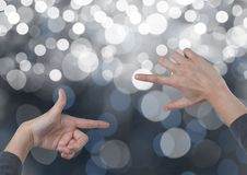 Hands creating rectangle invisible shape with sparkling light bokeh background. Digital composite of Hands creating rectangle invisible shape with sparkling stock images