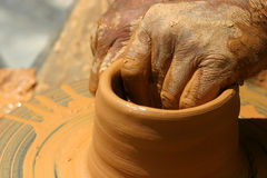 Hands creating a traditional vase Stock Photography