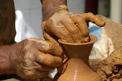 Hands creating a traditional vase Royalty Free Stock Images