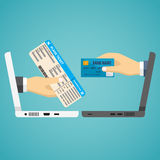 Hands with credit card and airplane ticket. Royalty Free Stock Photo