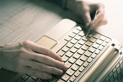 Hands with credit card and notebook Royalty Free Stock Images