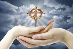Hands and Cross Royalty Free Stock Photography