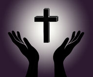 Hands and the cross Royalty Free Stock Photo