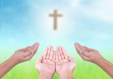 Hands with Cross. Hands bokeh with Holy Cross and the nature light stock image
