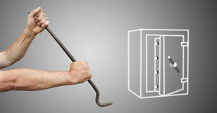 The hands with the crowbar break open the safe Stock Images