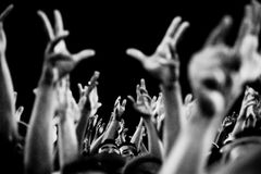 Hands of the crowd. Fans support the team during a football match Royalty Free Stock Images