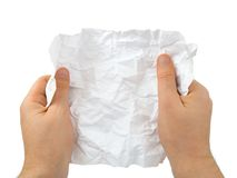 Hands and crumpled paper Stock Images