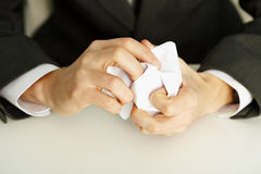 Hands crumpling a white paper Royalty Free Stock Photography