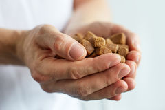 Hands with cubes of brown sugar Royalty Free Stock Photos