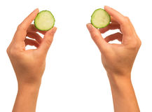 Hands with cucumber slices Stock Image