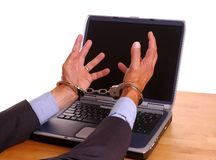 Hands Cuffed grabbing computer Royalty Free Stock Image