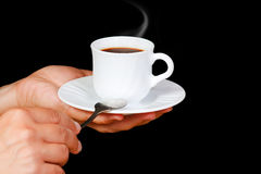 Hands with a cup of coffee with steam Royalty Free Stock Photography