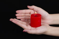 Hands cupped around a candle Royalty Free Stock Images