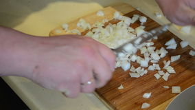 Hands cut onion with knife on board. healthy food prepare stock video footage