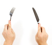 Hands and cutlery Royalty Free Stock Photography