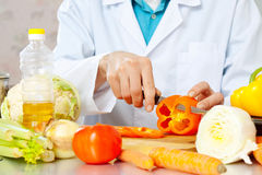 Hands cuts vegetables Royalty Free Stock Photography