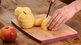 Hands cutting apple on cutting board.  stock video footage