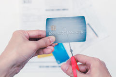 Hands cutting a credit card with scissors,woman is cutting credi Stock Image