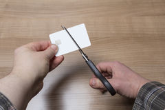 Hands cutting a credit or debit card Royalty Free Stock Image