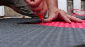 Hands cutting EVA foam stock footage
