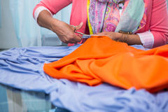 Hands cutting fabric at table Royalty Free Stock Photography