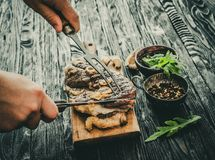 Grilled meat on a table stock images