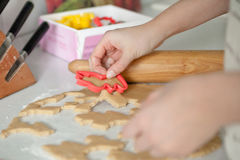 Hands Cutting Out Cookies Stock Photos
