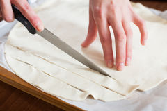 Hands cutting store-bought dough Stock Photo