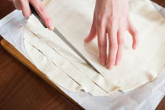 Hands cutting store-bought dough Royalty Free Stock Photos