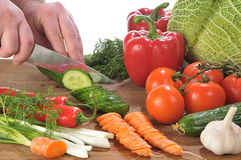 Hands cutting vegetables Royalty Free Stock Images
