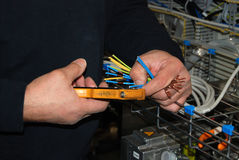 Hands cutting wires Stock Photo
