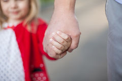 Hands of dad and daughter Royalty Free Stock Photo