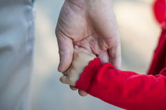 Hands of dad and daughter Stock Photos