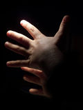 Hands in Dark. Hands are conducting something in dark Stock Image