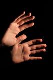 Hands in dark Stock Photos