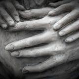 Hands in darkness Stock Photos