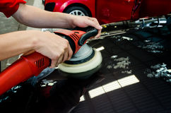 Hands with daul action polisher. polishing on car surface. hand Stock Photos