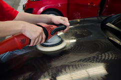 Hands with daul action polisher. polishing on car surface. hand Stock Images