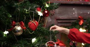 Hands decorate a fir-tree for Christmas stock video