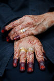 Hands Decorated with Henna. Close-up view of a bride's hands being decorated with henna Royalty Free Stock Image