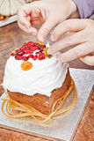 Hands decorating christmas cake Royalty Free Stock Photography