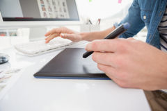 Hands of designer typing on keyboard and using digitizer Royalty Free Stock Photos