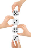 Hands and dices Stock Photos